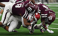NWA Democrat-Gazette/J.T. WAMPLER Arkansas' Rakeem Boyd gets tackled by a host of Texas A&M defenders Saturday Sept. 29, 2018 at AT&T Stadium in Arlington. Arkansas lost 17-24.