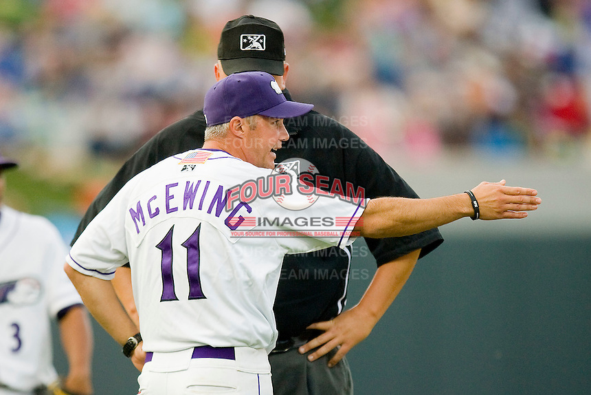 Winston-Salem Dash manager Joe McEwing #11 argues a call with base umpire Tyler Wilson during a Carolina League game against the Lynchburg Hillcats at  BB&T Ballpark May 22, 2010, in Winston-Salem, North Carolina.  Photo by Brian Westerholt / Four Seam Images