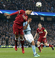Liverpool's Virgil van Dijk wins an aerial battle with Manchester City's Gabriel Jesus<br /> <br /> Photographer Rich Linley/CameraSport<br /> <br /> UEFA Champions League Quarter-Final Second Leg - Manchester City v Liverpool - Tuesday 10th April 2018 - The Etihad - Manchester<br />  <br /> World Copyright &copy; 2017 CameraSport. All rights reserved. 43 Linden Ave. Countesthorpe. Leicester. England. LE8 5PG - Tel: +44 (0) 116 277 4147 - admin@camerasport.com - www.camerasport.com