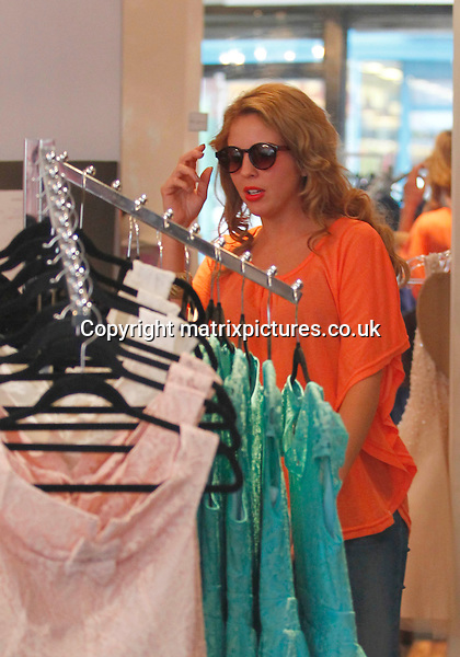 """EXCLUSIVE ALL ROUND PICTURE: MATRIXPICTURES.CO.UK.PLEASE CREDIT ALL USES..WORLD RIGHTS..""""The Only Way Is Essex"""" reality television star Lydia Bright is pictured at her vintage-inspired fashion boutique Bella Sorella in Loughton, Essex today...MARCH 26th 2012..REF: WBD 132000"""