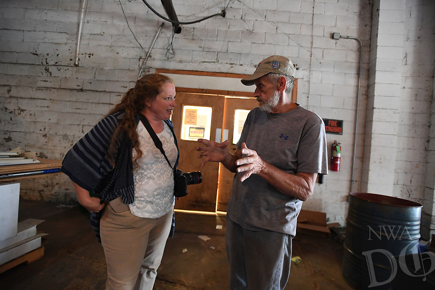 NWA Democrat-Gazette/J.T. WAMPLER  Sarah King, marketing and outreach with Specialized Real Estate Group (LEFT) visits with Rickie Drain Thursday August 8, 2019 at the former Farmers Cooperative building on Martin Luther King Jr. Blvd. Drain started working at the coop in 1966.<br /><br />Specialized Real Estate Group bought the property this year and plans to put in more than 200 apartments and renovate the existing properties for a mix of restaurants, entertainment, office and retail space.