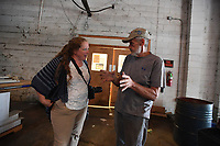 NWA Democrat-Gazette/J.T. WAMPLER  Sarah King, marketing and outreach with Specialized Real Estate Group (LEFT) visits with Rickie Drain Thursday August 8, 2019 at the former Farmers Cooperative building on Martin Luther King Jr. Blvd. Drain started working at the coop in 1966.<br />