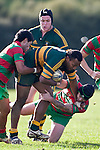 Seremaia Tagicakibau tries to push of the tackle of Baden Morey. Counties Manukau Premier Club Rugby game between Pukekohe and Waiuku played at Colin Lawrie Fields, Pukekohe, on Saturday July 3rd 2010. Pukekohe won 31 - 12 after leading 15 - 9 at halftime.
