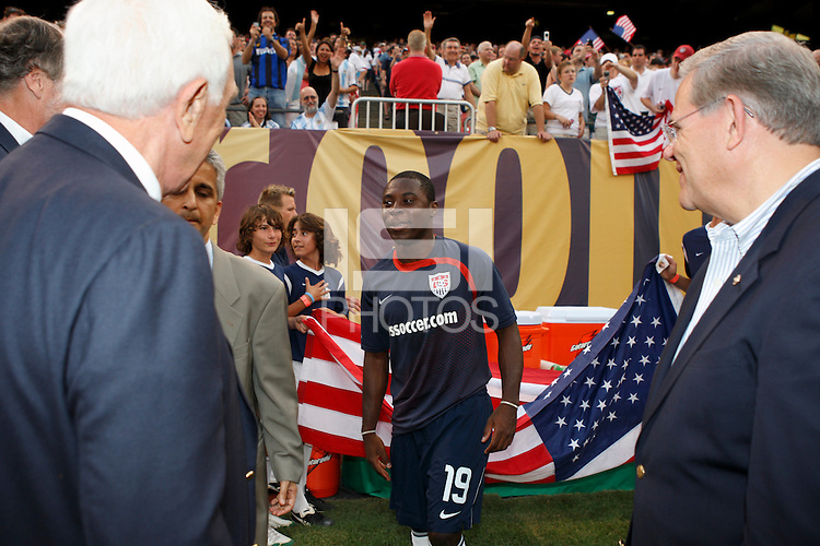 United States midfielder Freddy Adu (19) meets US Senators from New Jersey Frank Lautenberg and Bob Menendez prior to the match. The men's national teams of the United States and Argentina played to a 0-0 tie during an international friendly at Giants Stadium in East Rutherford, NJ, on June 8, 2008.
