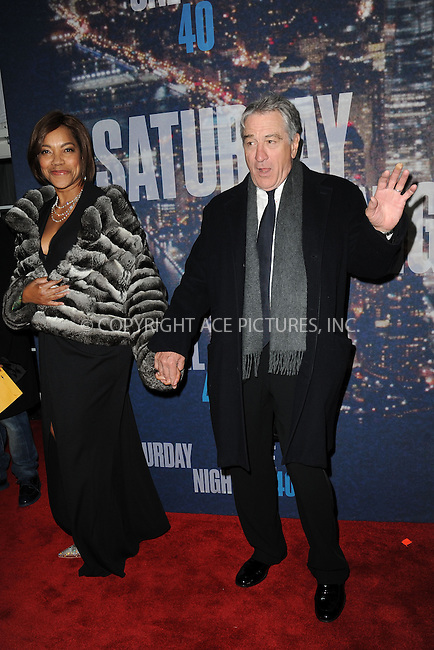 WWW.ACEPIXS.COM<br /> February 15, 2015 New York City<br /> <br /> Grace Hightower and Robert De Niro walking the red carpet at the SNL 40th Anniversary Special at 30 Rockefeller Plaza on February 15, 2015 in New York City.<br /> <br /> Please byline: Kristin Callahan/AcePictures<br /> <br /> ACEPIXS.COM<br /> <br /> Tel: (646) 769 0430<br /> e-mail: info@acepixs.com<br /> web: http://www.acepixs.com