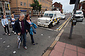 Local people pass some PSNI (Police Service of Northern Ireland) police landrovers in the center of Belfast ahead of this weeks G8 Summit in Fermanagh, Northern Ireland, Saturday, June 15, 2013. Photo/Paul McErlane.   Northern Ireland, 15 June 2013. Leaders from Canada, France, Germany, Italy, Japan, Russia, USA and UK are meeting at Lough Erne in Northern Ireland for the G8 Summit 17-18 June.
