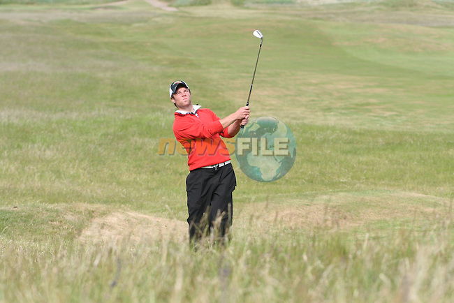 Shane Smyth of Co.Louth Golf Club hitting onto the 3rd green on day 2 of the 2010 East of Ireland Amateur Golf Competition in Co.Louth Golf Club...Photo NEWSFILE/Jenny Matthews.(Photo credit should read Jenny Matthews/NEWSFILE)....This Picture has been sent you under the condtions enclosed by:.Newsfile Ltd..The Studio,.Millmount Abbey,.Drogheda,.Co Meath..Ireland..Tel: +353(0)41-9871240.Fax: +353(0)41-9871260.GSM: +353(0)86-2500958.email: pictures@newsfile.ie.www.newsfile.ie.FTP: 193.120.102.198.