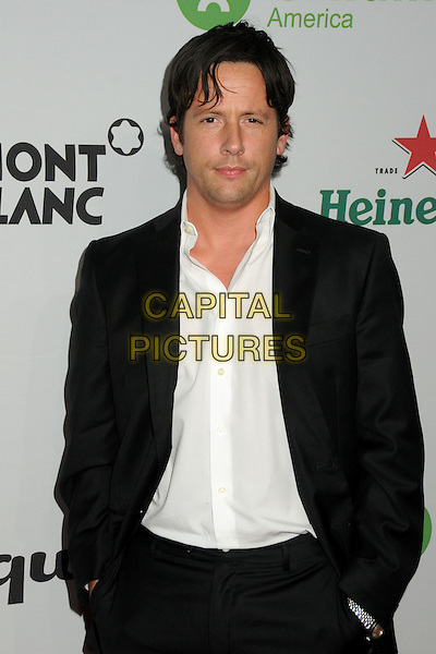 "ROSS McCALL .Oxfam America and Esquire House LA Host ""The Oxfam Party"" held at Esquire House LA, Los Angeles, California, USA, .18th November 2010..half length black suit white shirt hands in pockets .CAP/ADM/BP.©Byron Purvis/AdMedia/Capital Pictures."