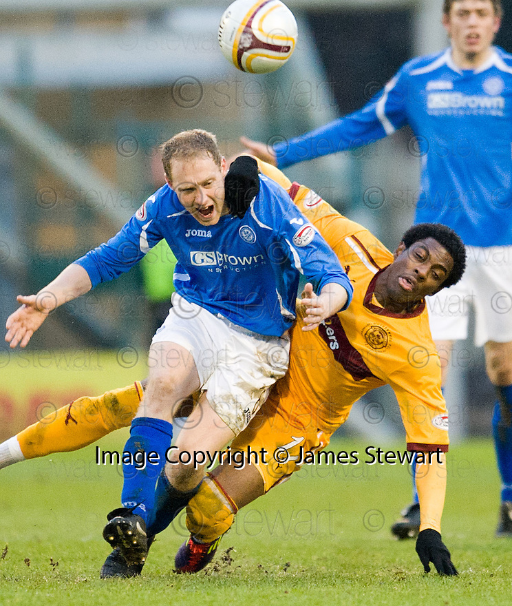 ST JOHNSTONE'S STEVEN ANDERSON IS PULLED DOWN BY MOTHERWELL'S OMAR DALEY