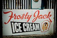 Tin 'Frosty Jack' icecream sign on a corregated wall at Bainham Store, Golden Bay, South Island, New Zealand - stock photo, canvas, fine art print