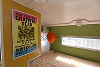 NWA Democrat-Gazette/FLIP PUTTHOFF <br /> Concert souvenirs decorate a trailer with a rock 'n roll theme. The kitchen counter is covered      June 21 2019   with hundreds of guitar picks beneath a smooth, clear coating.
