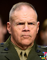 """United States Marine Corps General Robert B. Neller, Commandant of the Marine Corps testifies before the US Senate Committee on Armed Services during a hearing on """"Chain of Command's Accountability to Provide Safe Military Housing and Other Building Infrastructure to Service members and Their Families"""" on Capitol Hill in Washington, DC on Thursday, March 7, 2019.<br /> Credit: Ron Sachs / CNP/AdMedia"""