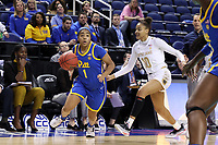 GREENSBORO, NC - MARCH 04: Dayshanette Harris #1 of the University of Pittsburgh gets past Katlyn Gilbert #10 of Notre Dame University before scoring the game-winning basket during a game between Pitt and Notre Dame at Greensboro Coliseum on March 04, 2020 in Greensboro, North Carolina.