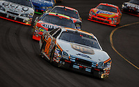 Apr 22, 2006; Phoenix, AZ, USA; Nascar Nextel Cup driver Dale Jarrett of the (88) UPS Ford Fusion leads a pack of cars during the Subway Fresh 500 at Phoenix International Raceway. Mandatory Credit: Mark J. Rebilas-US PRESSWIRE Copyright © 2006 Mark J. Rebilas..