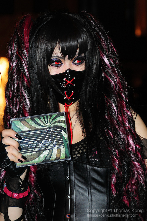 Kaohsiung, Taiwan -- A fan of Japanese metal band SOUNDWITCH, dressed in gothic garb, at a live concert of the band at The Wall Live House (Pier 2) in Kaohsiung, Taiwan.