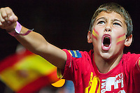 child celebrating Spain's second goal