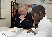 Washington, D.C. - November 2, 2005 -- Prince Charles goes over school work with SEED School student Bernard Ross, 13, wile touring the school in Washington, Wednesday, Nov. 2, 2005. The SEED School offers an intensive academic and boarding education to 320 urban children in grades seven through twelve. Prince Charles and Camilla are on an 8-day tour of the United States..Credit: AP Photo/Susan Walsh via CNP.(Restriction: No New York Metro or other Newspapers within a 75 mile radius of New York City)