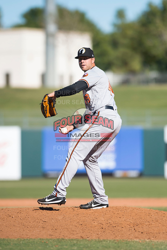 Glendale Desert Dogs relief pitcher Jay Flaa (48), of the Baltimore Orioles organization, delivers a pitch during an Arizona Fall League game against the Surprise Saguaros at Surprise Stadium on November 13, 2018 in Surprise, Arizona. Surprise defeated Glendale 9-2. (Zachary Lucy/Four Seam Images)