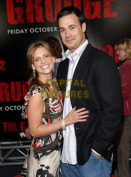 "SARAH MICHELLE GELLAR & FREDDIE PRINZE JR..attends The Columbia Pictures World Premiere of .""The Grudge 2"" held at Knott's Scary Farm in Buena Park, .California, USA, October 8th 2007..half length black and white red patterned print dress long gold studs married husband wife couple.Ref: DVS.www.capitalpictures.com.sales@capitalpictures.com.©Debbie VanStory/Capital Pictures"