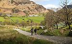Two people walking, Glenridding, Lake District, Cumbria, England, UK
