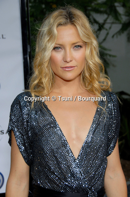 Kate Hudson arriving at the YOU, ME AND DUPREE Premiere at the Arclight Theatre  In Los Angeles. July 10,  2006.<br /> head shot<br /> no smile<br /> serious