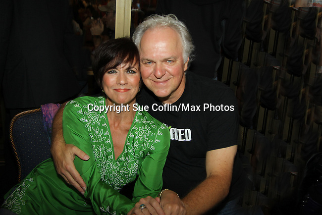 As The World Turns' Colleen Zenk poses with PJ Benjamin (Wizard in Wicked) at the autograph table during The 24th Annual Broadway Flea Market & Grand Auction to benefit Broadway Cares/Equity Fight Aids on September 26, 2010 in Shubert Alley, New York City, New York. (Photo by Sue Coflin/Max Photos)