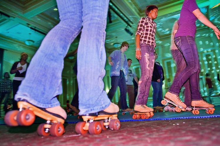 Cierra Johnson, center, rollerskates Tuesday night with other students at the Baker Center.