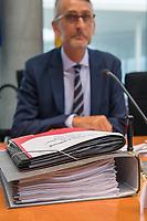 10. Sitzung des &quot;1. Untersuchungsausschuss&quot; der 19. Legislaturperiode des Deutschen Bundestag am Donnerstag den 17. Mai 2018 zur Aufklaerung des Terroranschlag durch den islamistischen Terroristen Anis Amri auf den Weihnachtsmarkt am Berliner Breitscheidplatz im Dezember 2016.<br /> In der Sitzung wurden in einer oeffentlichen Anhoerung als Sachverstaendige zum Thema: &quot;Foederale Sicherheitsarchitektur&quot; u.a. der ehemalige Chef des Bundesamt fuer Verfassungssschutz (Heinz Fromm), der ehemalige Direktor des Bundeskriminalamt (Juergen Maurer) und Rechtswissenschaftler befragt.<br /> Im Bild: Ausschussakten vor dem  Ausschussvorsitzenden Armin Schuster (CDU).<br /> 17.5.2018, Berlin<br /> Copyright: Christian-Ditsch.de<br /> [Inhaltsveraendernde Manipulation des Fotos nur nach ausdruecklicher Genehmigung des Fotografen. Vereinbarungen ueber Abtretung von Persoenlichkeitsrechten/Model Release der abgebildeten Person/Personen liegen nicht vor. NO MODEL RELEASE! Nur fuer Redaktionelle Zwecke. Don't publish without copyright Christian-Ditsch.de, Veroeffentlichung nur mit Fotografennennung, sowie gegen Honorar, MwSt. und Beleg. Konto: I N G - D i B a, IBAN DE58500105175400192269, BIC INGDDEFFXXX, Kontakt: post@christian-ditsch.de<br /> Bei der Bearbeitung der Dateiinformationen darf die Urheberkennzeichnung in den EXIF- und  IPTC-Daten nicht entfernt werden, diese sind in digitalen Medien nach &sect;95c UrhG rechtlich geschuetzt. Der Urhebervermerk wird gemaess &sect;13 UrhG verlangt.]