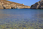 Shoreline clear blue sea water, Mgarr ix-Xini coastal inlet, island of Gozo, Malta tour boat arriving