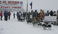 Saturday February 25, 2006 Willow, Alaska.   Nikolai Buser leaves the start line of the Junior Iditarod sled dog race.  Willow Lake.