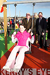 SWING: Sarah Kate Daly (Fenit) getting a push on the new swing from Dick Roche, Minister of the Environment, Heritage and Local Government, after he offically opened the new Playground at Fenit on Friday.