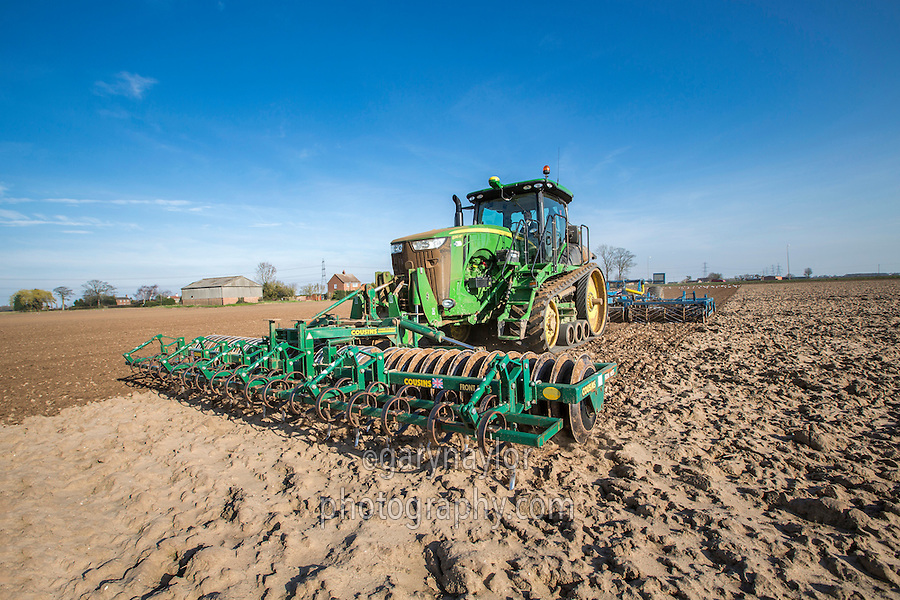 Cultivating sugar beet seed bed with Ja ohn Deere 8310RT and six meter Preperator - Lincolnshire, March