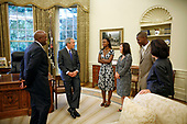 United States President George W. Bush meets with the Big Brother and Big Sister of the Year in the Oval Office Friday, July 28, 2006. From left, they are: Big Brother of the Year Sylvester Fulton of Memphis, Tenn.; LaMecca Butler, Betsy's little sister; Big Sister of the Year Betsy Gorman-Bernardi of Albany, N.Y.; Jeremy Moore, Sylvester's little brother; and President and CEO Judy Vredenburgh of BBBS of America. <br /> Mandatory Credit: Paul Morse / White House via CNP