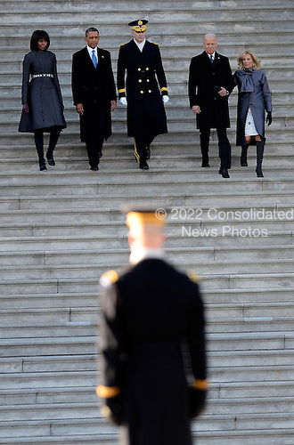 United States President Barack Obama (2L) his wife Michelle Obama (L), Vice President Joe Biden (2R) and his wife Dr Jill Biden (R) and US Army Major General Michael J. Linnington (C) walk down the stairs before the Presidential review of the troops on the east side of the United States Capitol following Obama's Inaugural address and ceremonially swearing in for a second term as the 44th President of the United States in Washington, DC, USA, 21 January 2013. Obama defeated Republican candidate Mitt Romney on Election Day 06 November 2012 to be re-elected for a second term..Credit: CJ Gunther / Pool via CNP