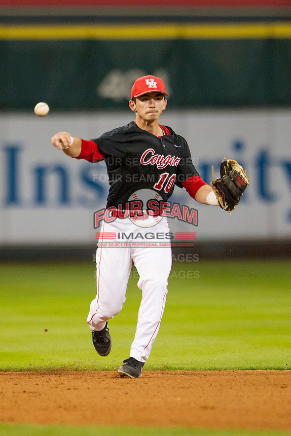 Houston Cougars shortstop Connor Wong (10) makes a throw to first base during the NCAA baseball game against the LSU Tigers on March 6, 2015 at Minute Maid Park in Houston, Texas. LSU defeated Houston 4-2. (Andrew Woolley/Four Seam Images)