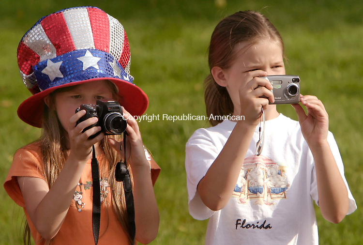 MIDDLEBURY, CT--28 MAY 2006 -052806JS02---Amanda Hermonot, 11, left and her sister Sarah, 8, take pictures of participants in the annual Middlebury Memorial Day parade held on Sunday.  Jim Shannon Republican-American