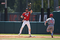 Northeastern Huskies first baseman Jake Farrell (18) waits for the throw as J.T. Jarrett (42) of the North Carolina State Wolfpack hustles down the line at Doak Field at Dail Park on June 2, 2018 in Raleigh, North Carolina. The Wolfpack defeated the Huskies 9-2. (Brian Westerholt/Four Seam Images)