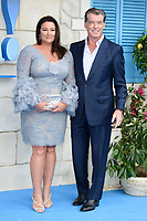 """Pierce Brosnan and wife Keeley<br /> arriving for the """"Mama Mia! Here We Go Again"""" World premiere at the Eventim Apollo, Hammersmith, London<br /> <br /> ©Ash Knotek  D3415  16/07/2018"""