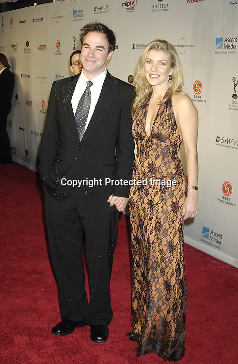 Roger Bart and Joanne Manning ..at the Arrivals of the 33rd  International Emmy Awards Gala on November 21, 2005 at the New York Hilton. ..Photo by Robin Platzer, Twin Images