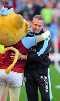 Saturday 15 September 2012<br /> Pictured: Aston Villa manager Paul Lambert (R) is greeted by team mascot.<br /> Re: Barclay's Premier League, Aston Villa v Swansea City FC at Villa Park, West Midlands, UK.