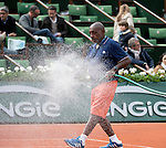May 23,2016:   Groundsman spraying clay court with water ©Leslie Billman/Tennisclix CSM