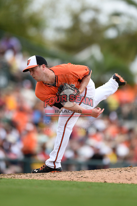 Baltimore Orioles pitcher Steve Johnson (52) during a spring training game against the Pittsburgh Pirates on March 23, 2014 at Ed Smith Stadium in Sarasota, Florida.  Baltimore and Pittsburgh tied 7-7.  (Mike Janes/Four Seam Images)