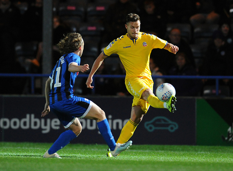 Bolton Wanderers' Dennis Politic under pressure from Rochdale's Luke Matheson<br /> <br /> Photographer Kevin Barnes/CameraSport<br /> <br /> EFL Leasing.com Trophy - Northern Section - Group F - Rochdale v Bolton Wanderers - Tuesday 1st October 2019  - University of Bolton Stadium - Bolton<br />  <br /> World Copyright © 2018 CameraSport. All rights reserved. 43 Linden Ave. Countesthorpe. Leicester. England. LE8 5PG - Tel: +44 (0) 116 277 4147 - admin@camerasport.com - www.camerasport.com
