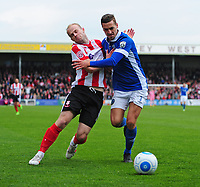 Lincoln City's Bradley Wood vies for possession with Macclesfield Town's David Fitzpatrick<br /> <br /> Photographer Chris Vaughan/CameraSport<br /> <br /> Vanarama National League - Lincoln City v Macclesfield Town - Saturday 22nd April 2017 - Sincil Bank - Lincoln<br /> <br /> World Copyright &copy; 2017 CameraSport. All rights reserved. 43 Linden Ave. Countesthorpe. Leicester. England. LE8 5PG - Tel: +44 (0) 116 277 4147 - admin@camerasport.com - www.camerasport.com