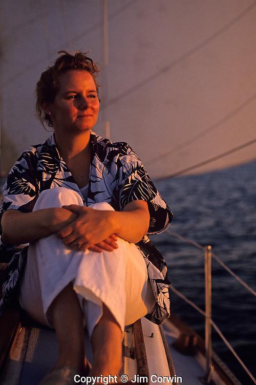Woman enjoying sailing on a sunny day at sunset on Puget Sound Seattle Washington State USA   MR
