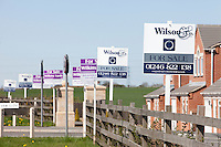Property For Sale boards outside new houses in Nottinghamshire