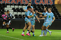 Nick Grigg (centre) of Glasgow Warriors celebrates scoring his sides fourth try with team mates during the Guinness Pro14 Round 8 match between the Ospreys and Glasgow Warriors at the Liberty Stadium in Swansea, Wales, UK. Friday 2nd November 2018