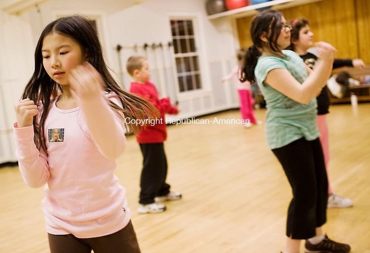 NAUGATUCK, CT--5 December 07--120507TJ01 - Olivia Creager, 9, from left, Norma Fayed, 11, and Melinda Ramadani, 8, exercise during the kidrobics class at the Naugtauck YMCA on Wednesday, December 5, 2007. T.J. Kirkpatrick/Republican-American