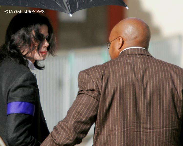 Michael Jackson walks gingerly into the courtroom for the 16th day of his child molestation trial in Santa Maria, Calif on Monday, March 21, 2005. ..