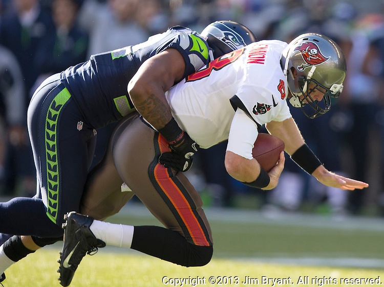 Seattle Seahawks linebacker Bruce Irvin sacks Tampa Bay Buccaneers quarterback Mike Glennon in the third quarter at CenturyLink Field in Seattle, Washington on November 3, 2013.  Glennon completed 17 of 23 passes for 168 yards for two touchdowns in the Seahawks come from behind win over  the Buccaneers 27-24 in overtime. ©2013. Jim Bryant. All Rights Reserved.